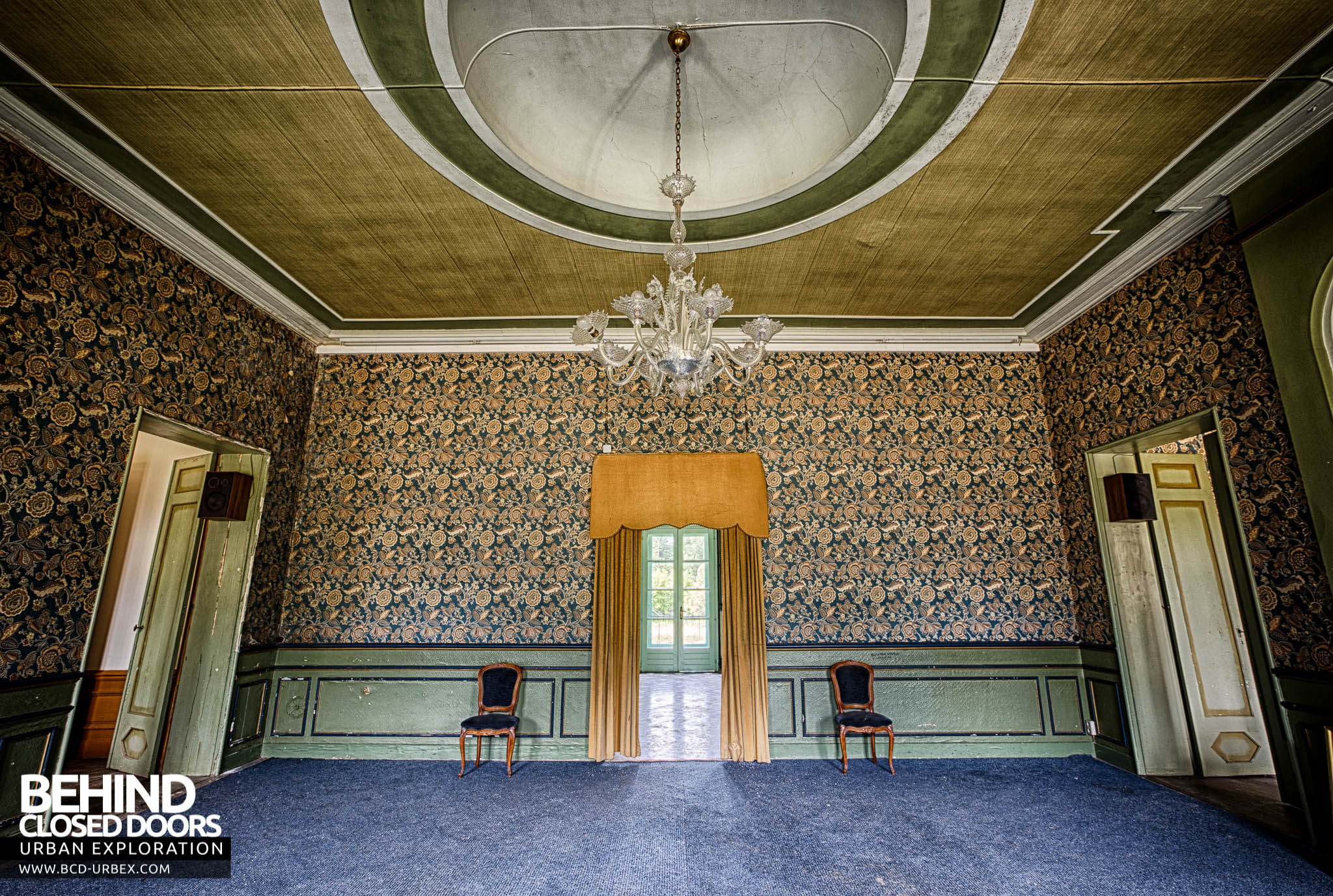 chateau de la chapelle the grand room with chairs and curtained doorway chateau de la chapelle belgium