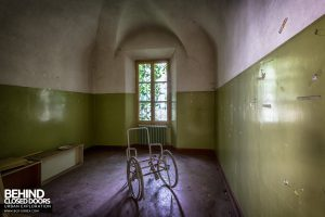 Manicomio di Colorno, Italy - Wheelchair in a room