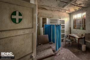 T. G. Greens Pottery - Cross on medical room door