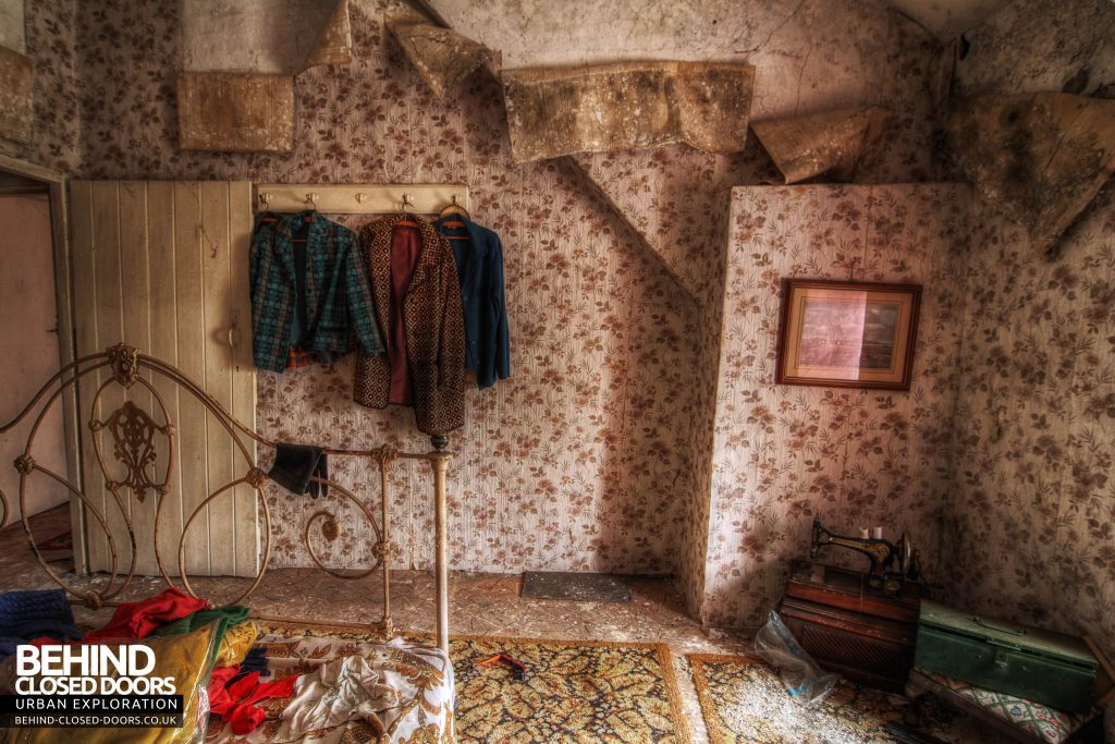 Y Heulog Farmhouse - Bedroom with jackets and sewing machine