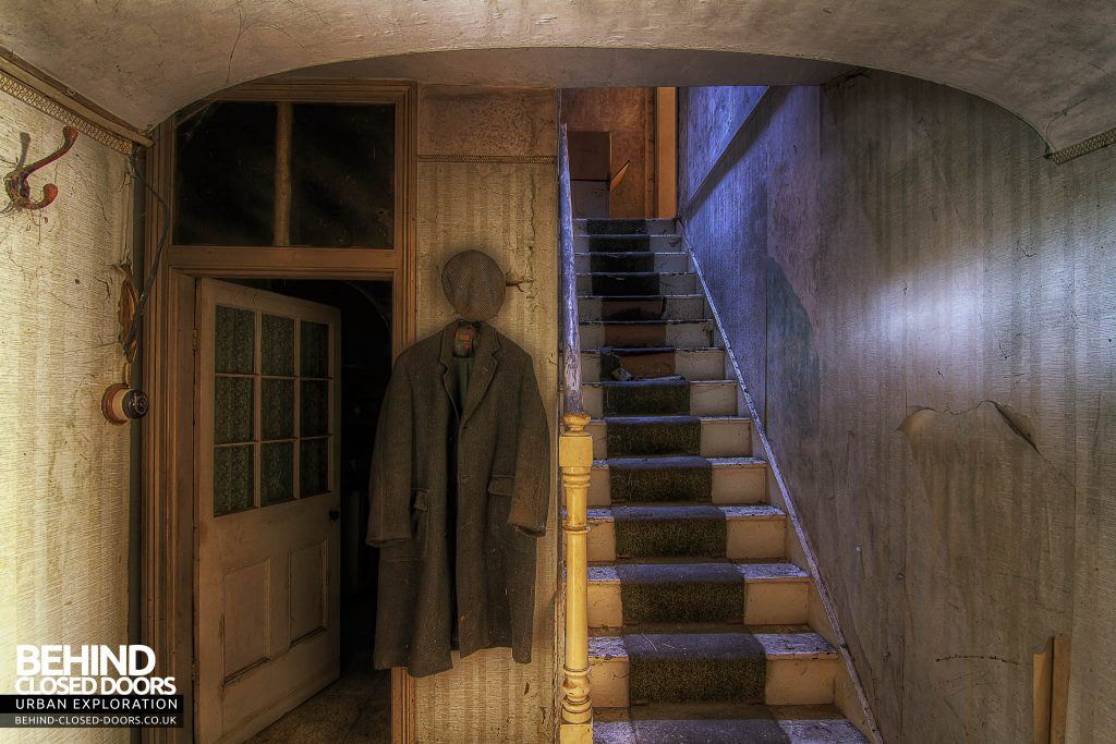 The Sewing House - Hanging Coat and Hat by the Stairs