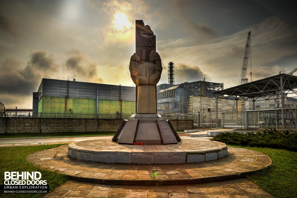 Chernobyl Nuclear Power Plant - The monument commemorating those who lost their lives in the Chernobyl disaster standing in front of reactor 4