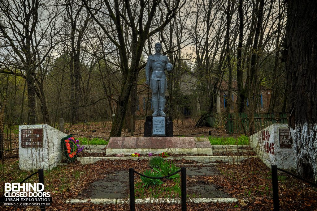Chernobyl Nuclear Power Plant - A war memorial in front of an abandoned nursery in Chernobyl town