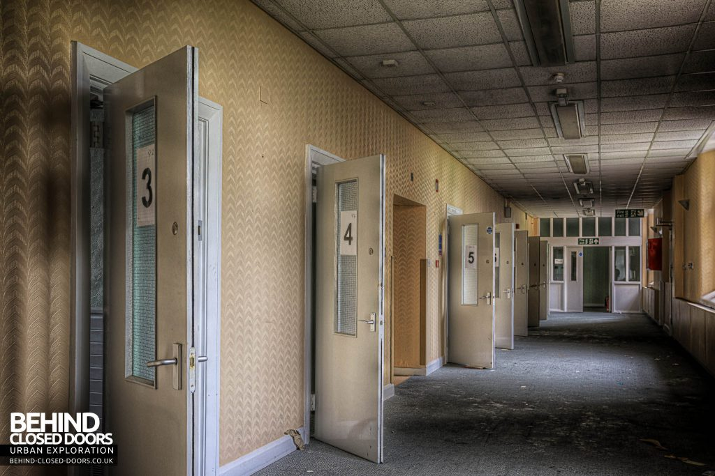 Shelton Asylum - A corridor of doors, with many rooms for patients