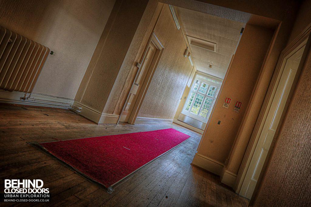 Shelton Asylum - Red carpet in admin area