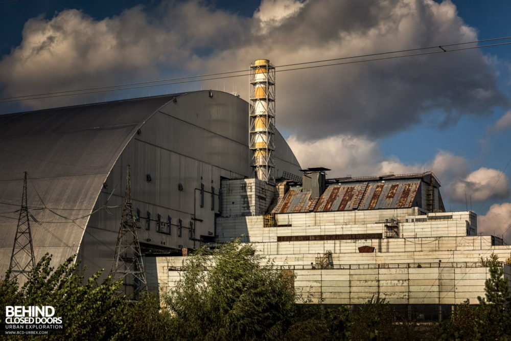 Chernobyl Power Plant - The reactor building of unit 3 and the New Safe Confinement (NSC) positioned over unit 4