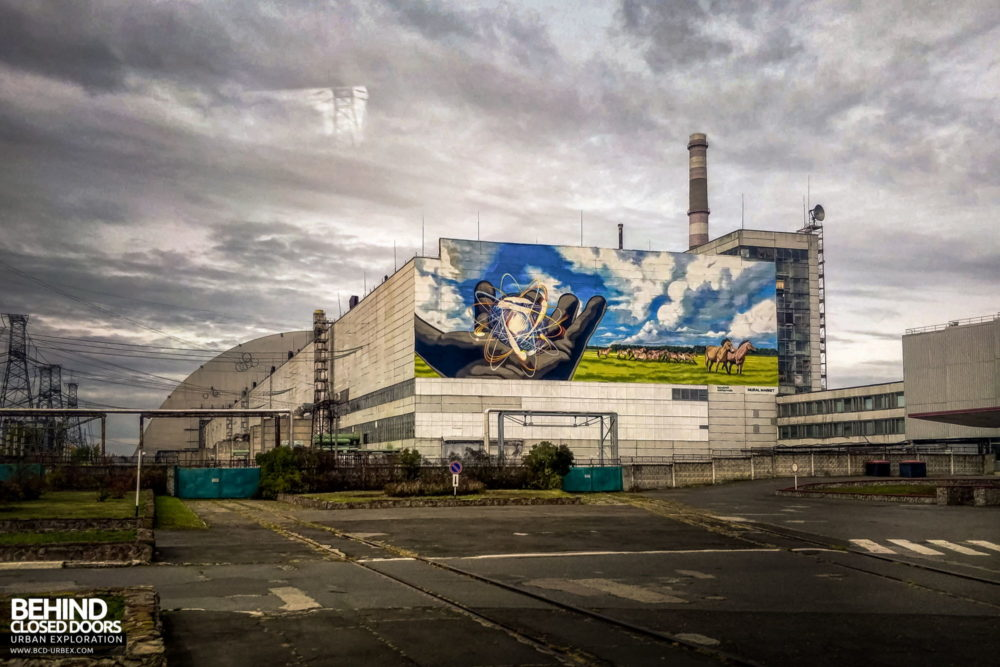 "Chernobyl Power Plant - The power plant in 2019, with a new mural named ""Looking into the Future"", painted by Valeriy Korshunov on the eastern wall"