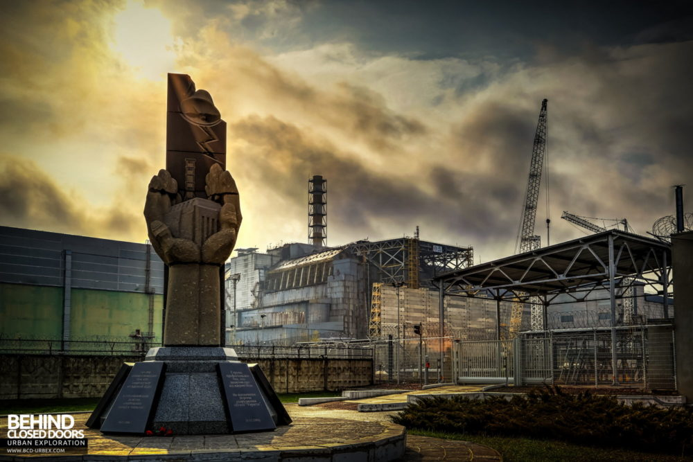 The monument commemorating those who lost their lives in the Chernobyl disaster standing in front of reactor 4, as seen in 2014 before the NSC was moved into position