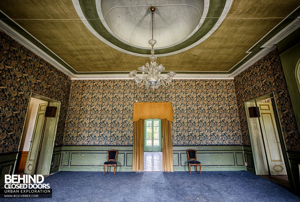Chateau de la Chapelle - The grand room with chairs and curtained doorway