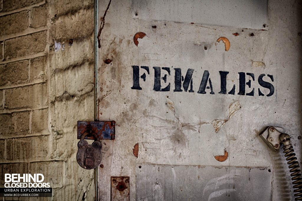 "Globe Worsted Mills - Padlocked door marked ""females"""