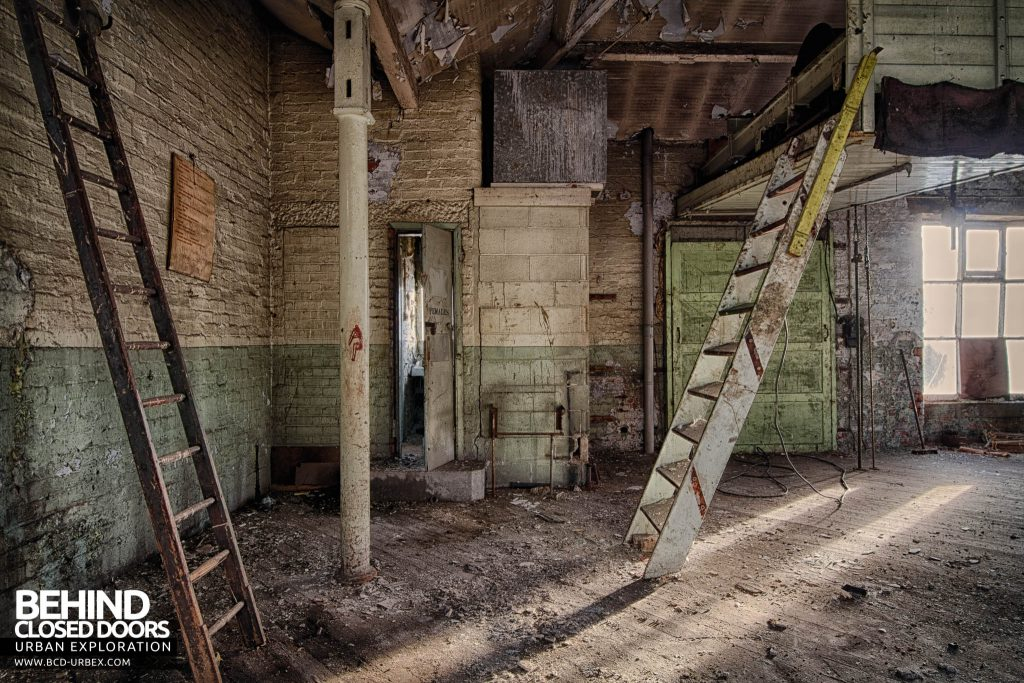 Globe Worsted Mills - Ladders and steps on the decaying top floor
