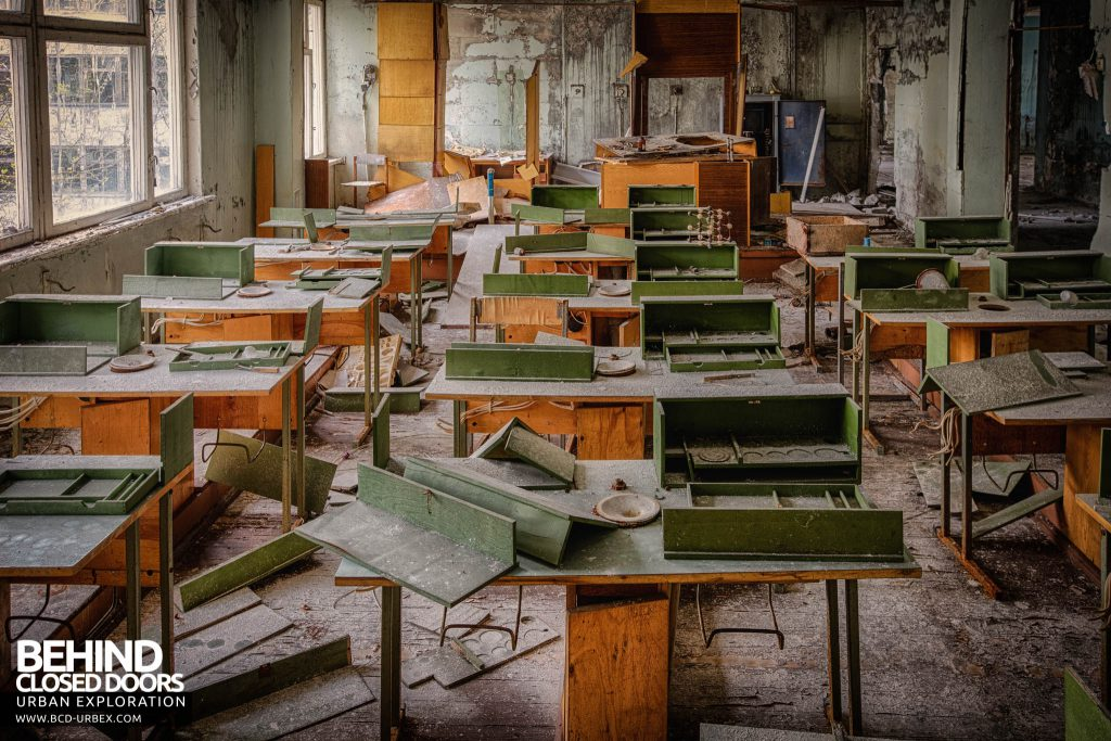 Pripyat Schools and Nurseries - Classroom with lots of items on the desks
