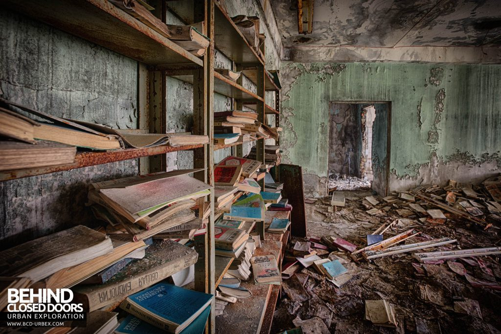 Pripyat Schools and Nurseries - Books remain on shelves in the school library