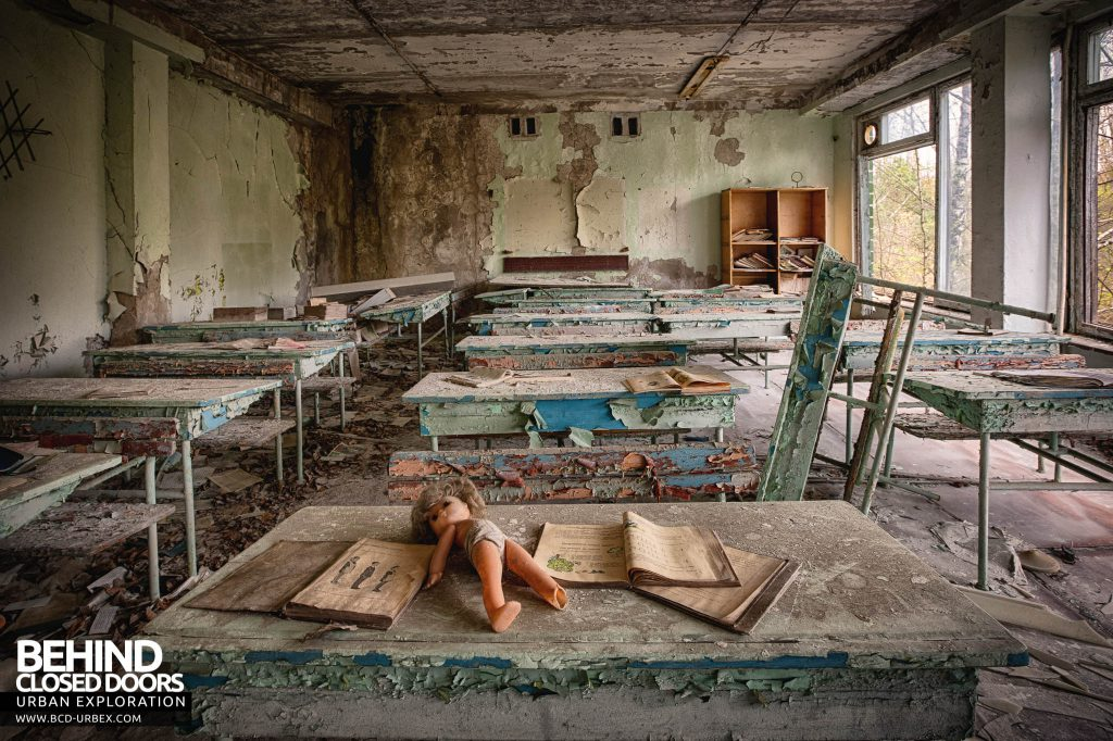 Pripyat Schools and Nurseries - Doll on a desk in a classroom