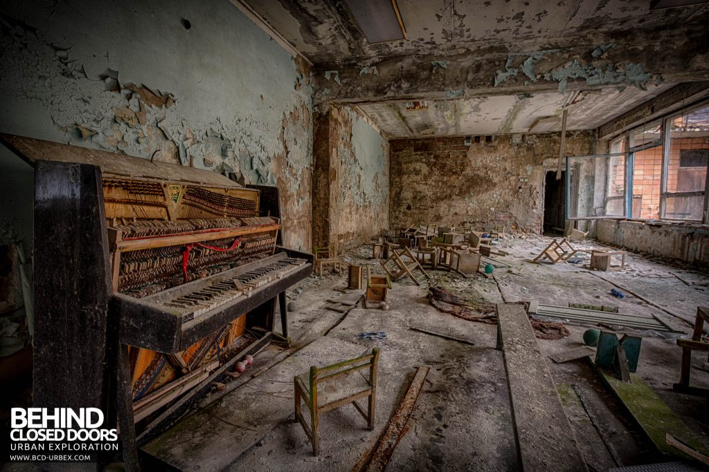 Pripyat Schools and Nurseries - A piano with tiny child sized chairs