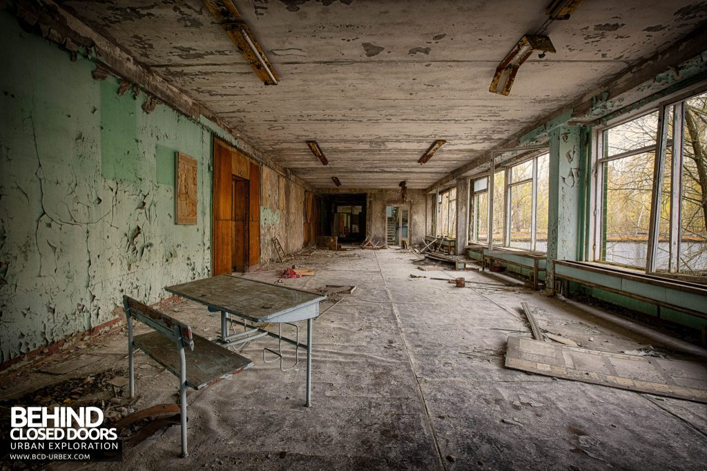 Pripyat Schools and Nurseries - School corridor with a desk in it