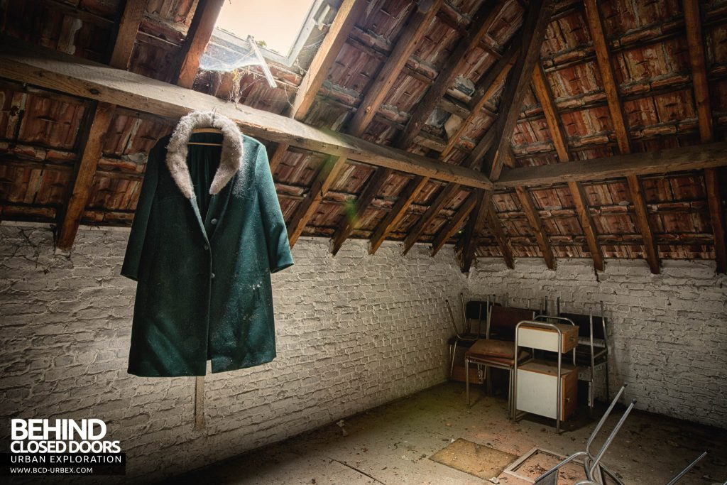 Salve Mater Psychiatric Hospital - Coat hanging under a skylight in the attic