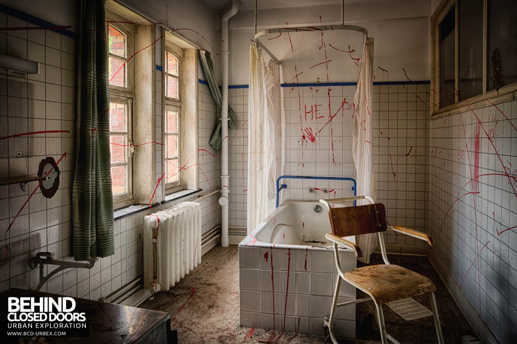 Salve Mater Psychiatric Hospital - Help scrawled across a bathroom wall