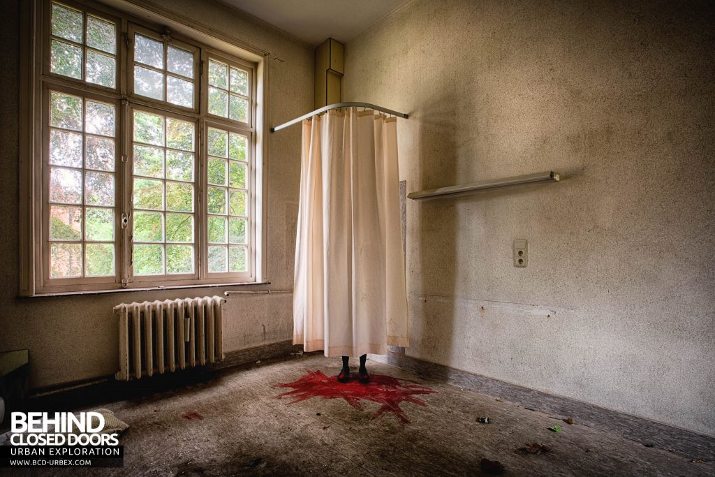 Salve Mater Psychiatric Hospital - Boots behind a curtain. This scene really makes you jump when you first encounter it!