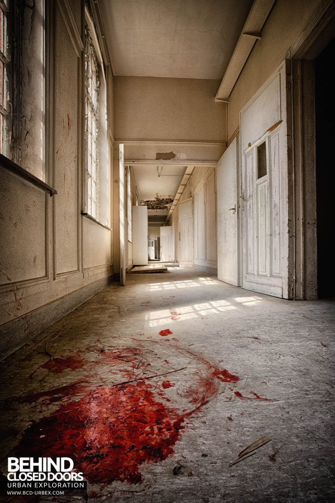 Salve Mater Psychiatric Hospital - Corridor with red substance resembling blood on the floor