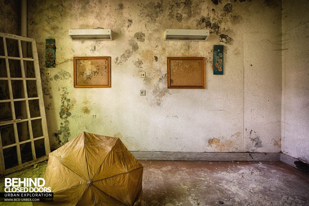 Salve Mater Psychiatric Hospital - Pictures on a wall behind a random umbrella