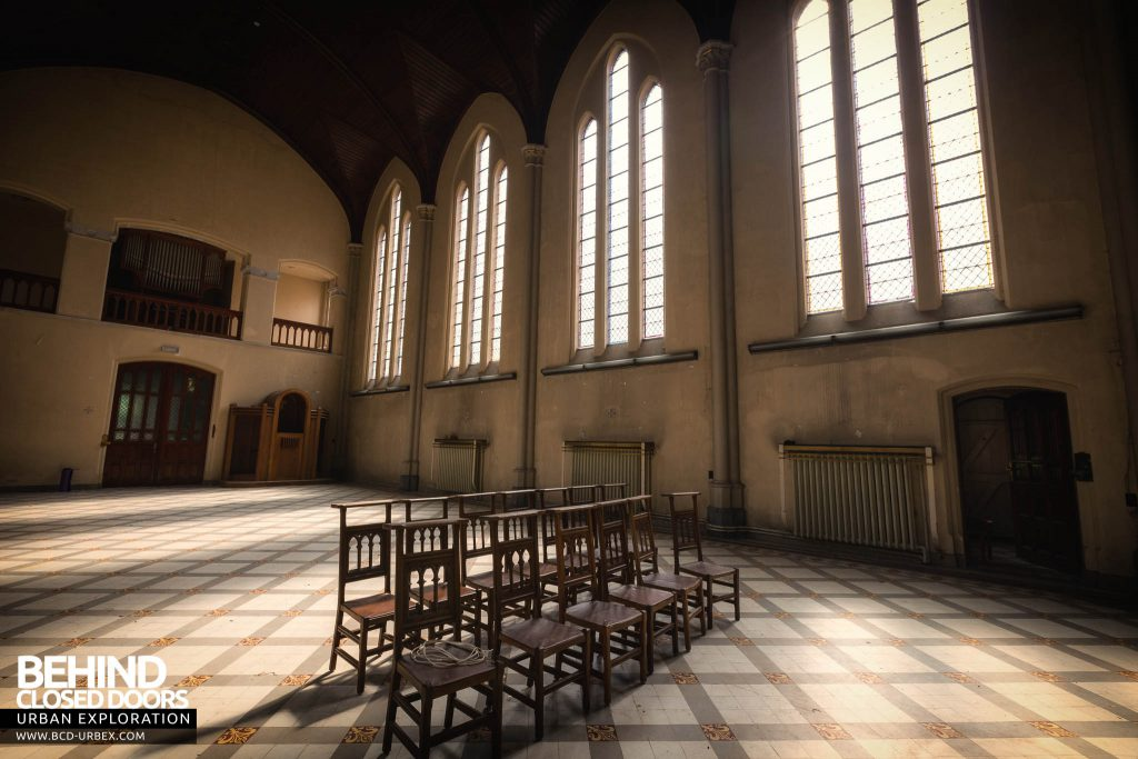 Salve Mater Psychiatric Hospital - Two rows of chairs under sunny windows in the chapel