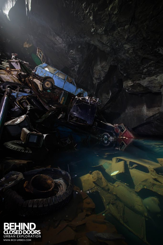 Cavern of the Lost Souls - Some cars are under the clear water