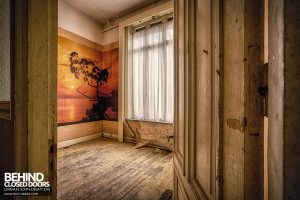 Hotel Thermale -Through the door of room with mural on the wall
