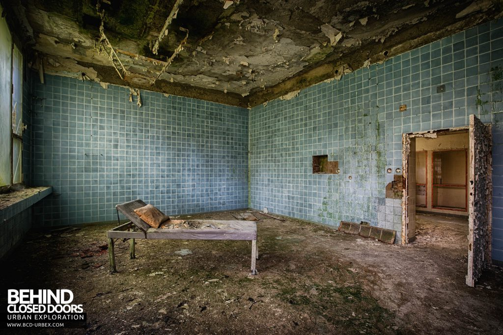 Blue Theatre Hospital - Operating theatre with old bed