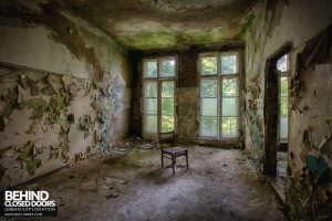 Blue Theatre Hospital - Chair in decaying room