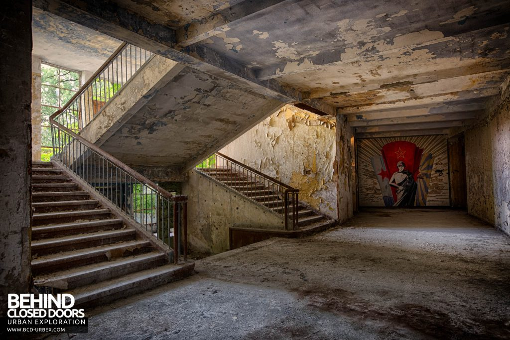 CCCP Flight School - Mural at end of corridor with staircase