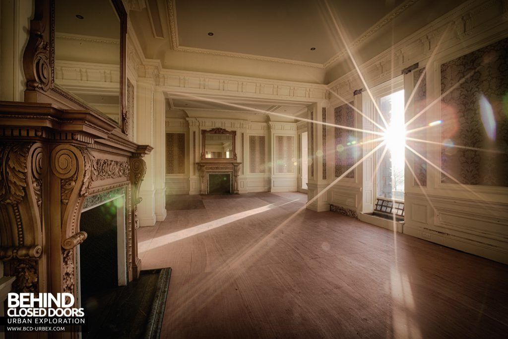 Stanford Hall - Morning sun shines into a room with two fireplaces