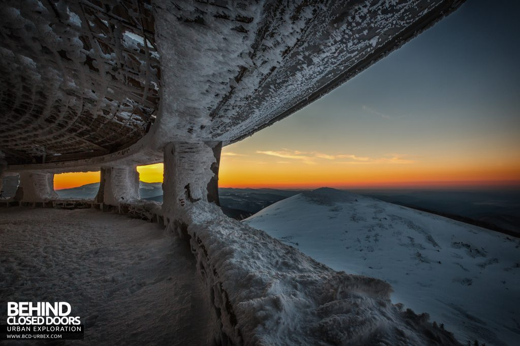 Buzludzha - As the sun sets the sky lights up orange
