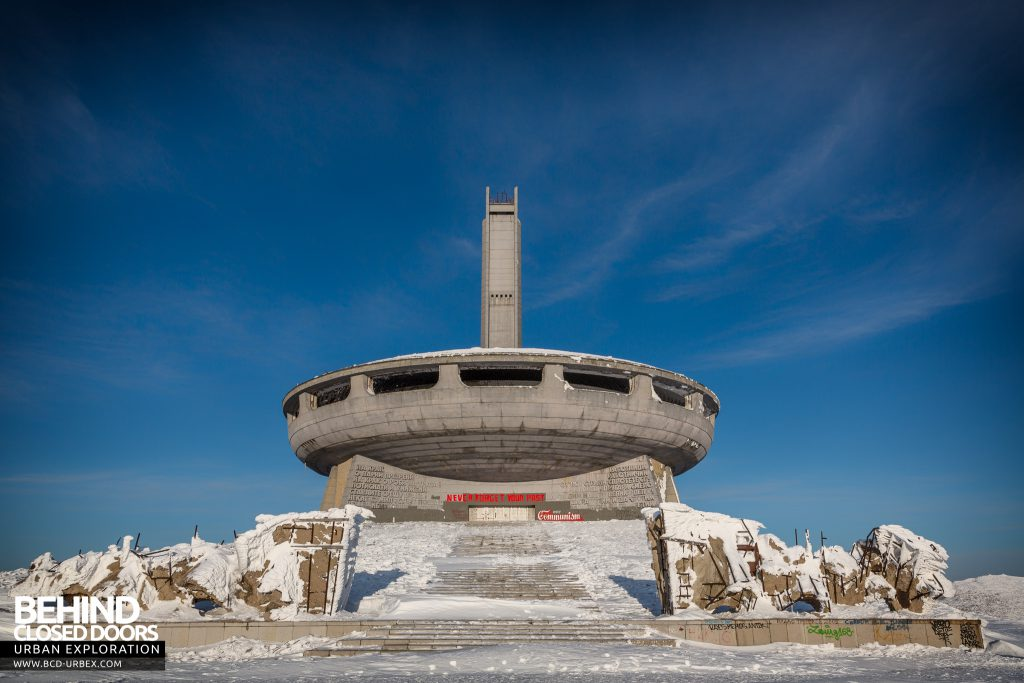 Buzludzha - The huge monument from the front with steps leading up between flame sculptures
