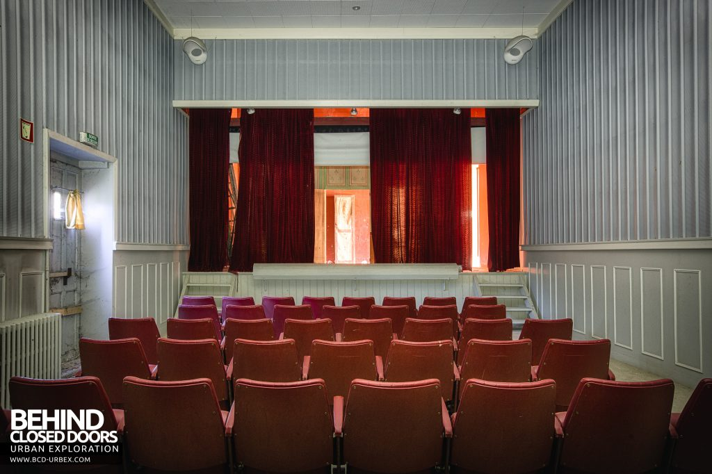 Hospital Plaza - Theatre with red seats and curtain