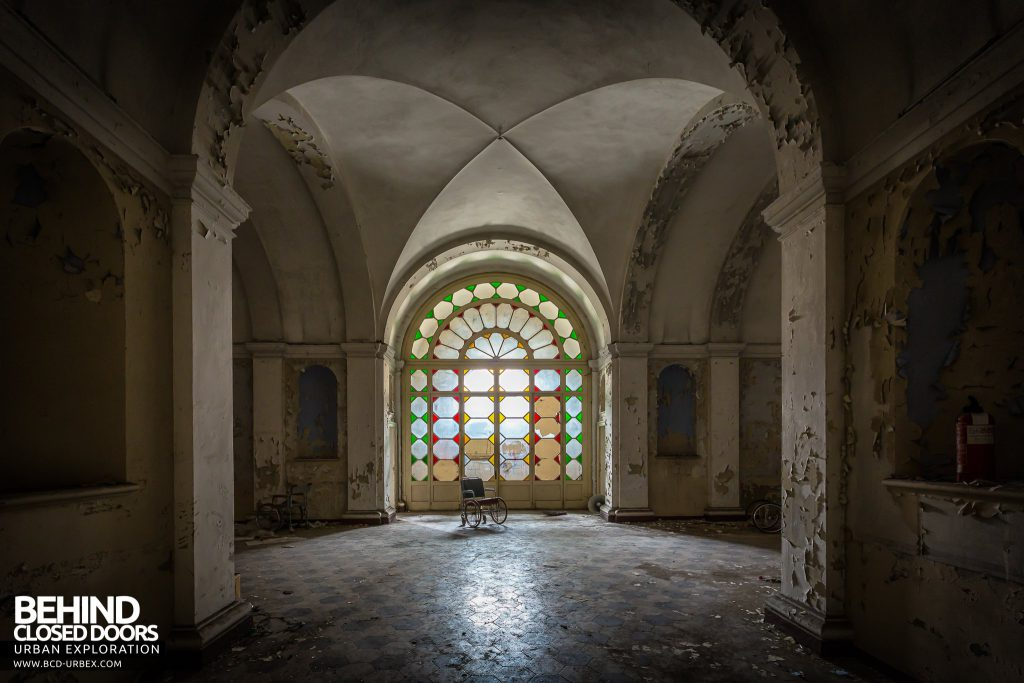 Manicomio di Colorno, Italy - Light pours through stained glass window into the grand entrance hall