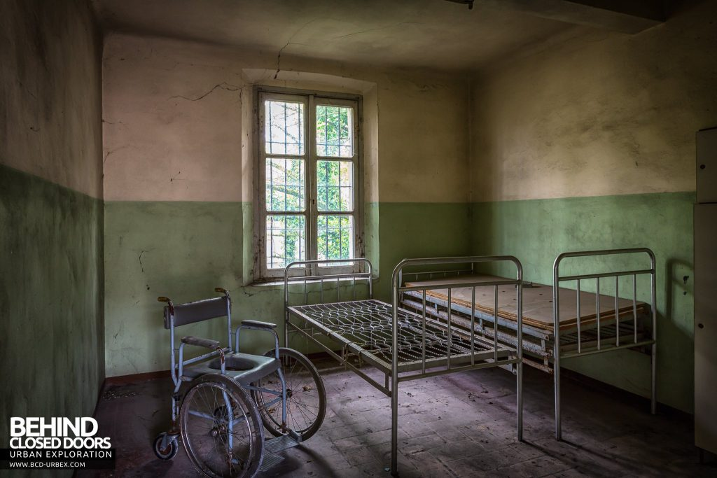 Manicomio di Colorno, Italy - Room containing a wheelchair and beds
