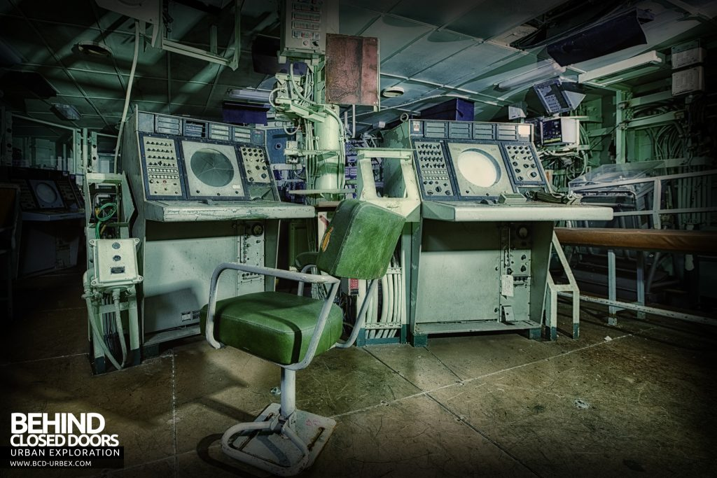 Atlantic Ghost Fleet - Chair in front of many radar consoles