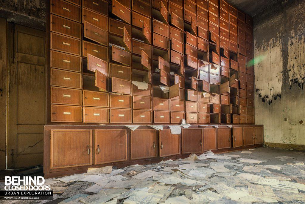 Manicomio di Racconigi - Pigeon Holes with paperwork strewn across the floor