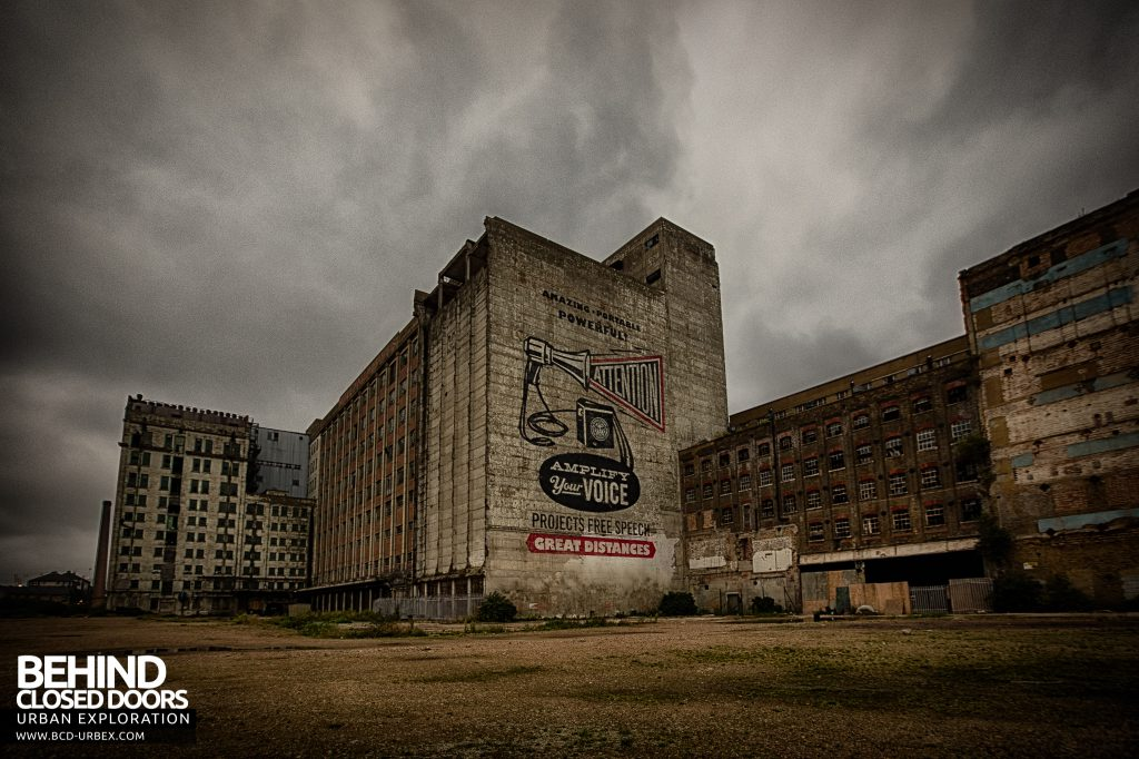 "Millennium Mills - ""Obey"" artwork on exterior wall"