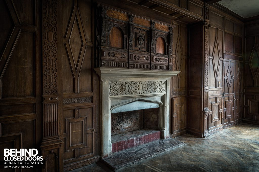 Carmel College - Ornate wood panelling around fireplace