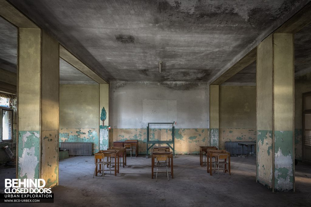 Mono Orphanage, Italy - Pillars and desks in classroom