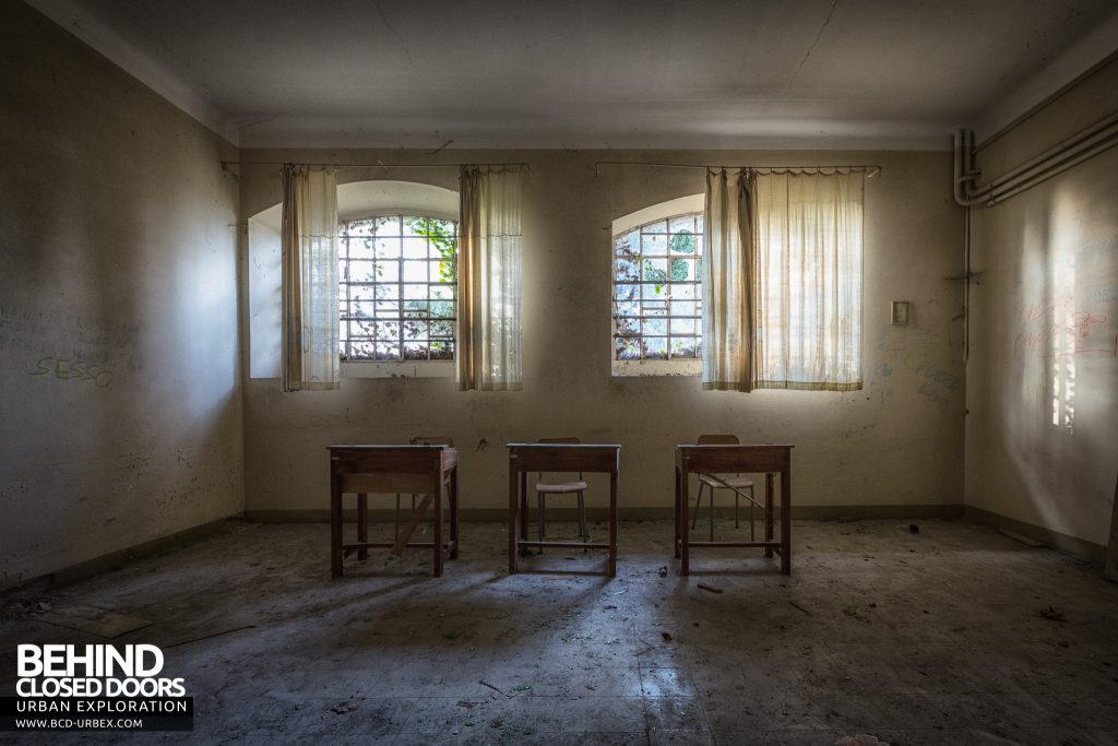 Mono Orphanage, Italy - Three desks in a room