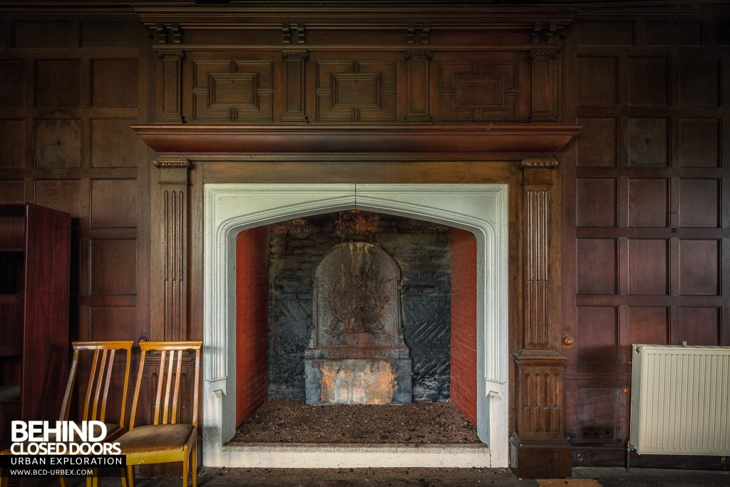 Pitchford Hall - Large fireplace surrounded by timber