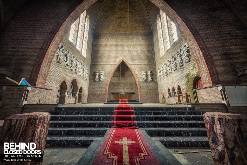 Rainbow Church, Netherlands - Cross on red carpet leading to the altar