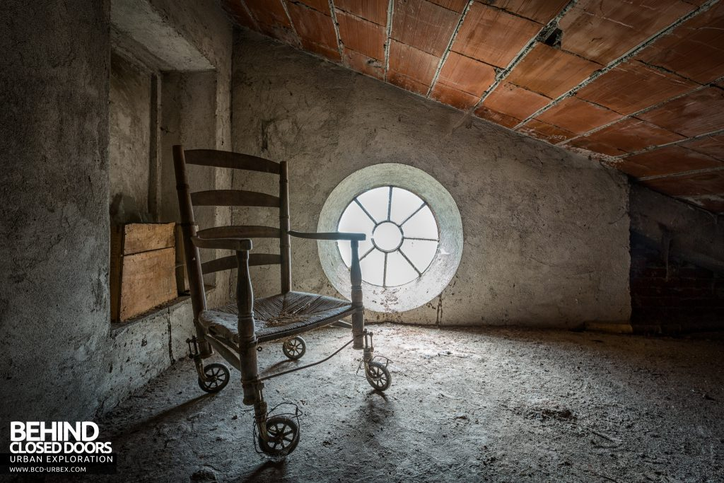 Monastero MG, Italy - Wheeled chair in attic
