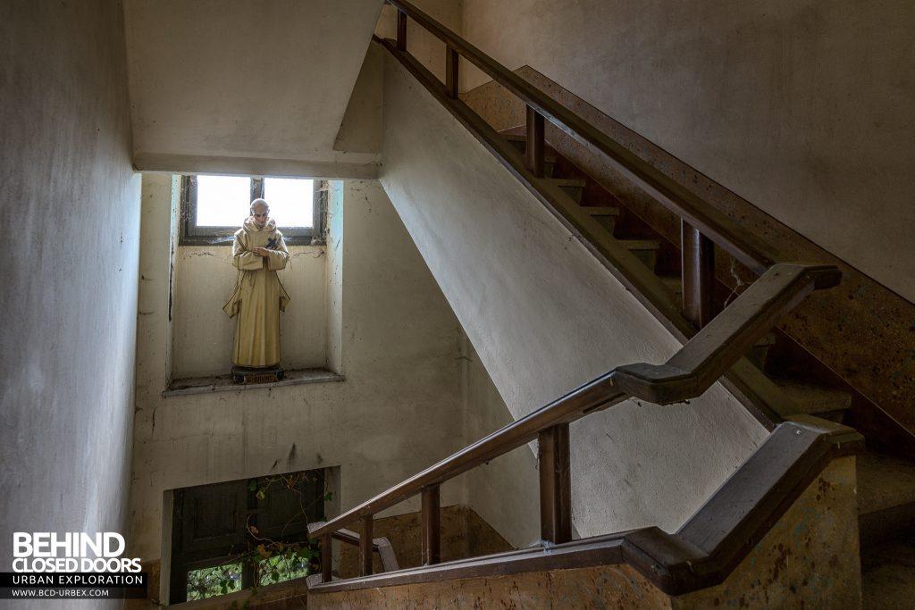 Monastero MG, Italy - Statue on stairway