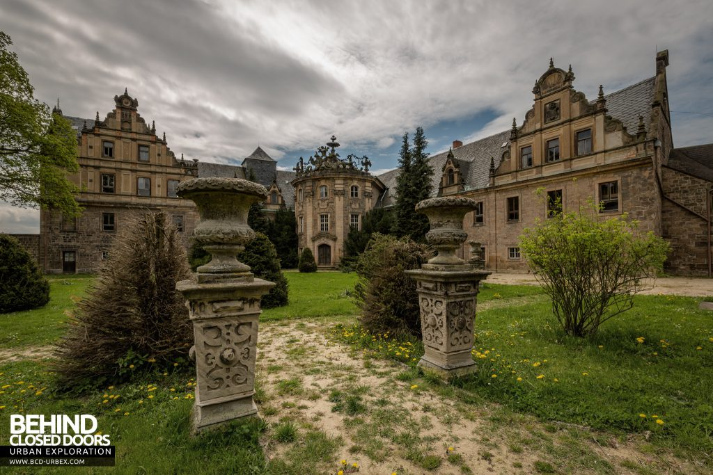 Schloss V, Germany - Front of the grand building with pathway between pillars