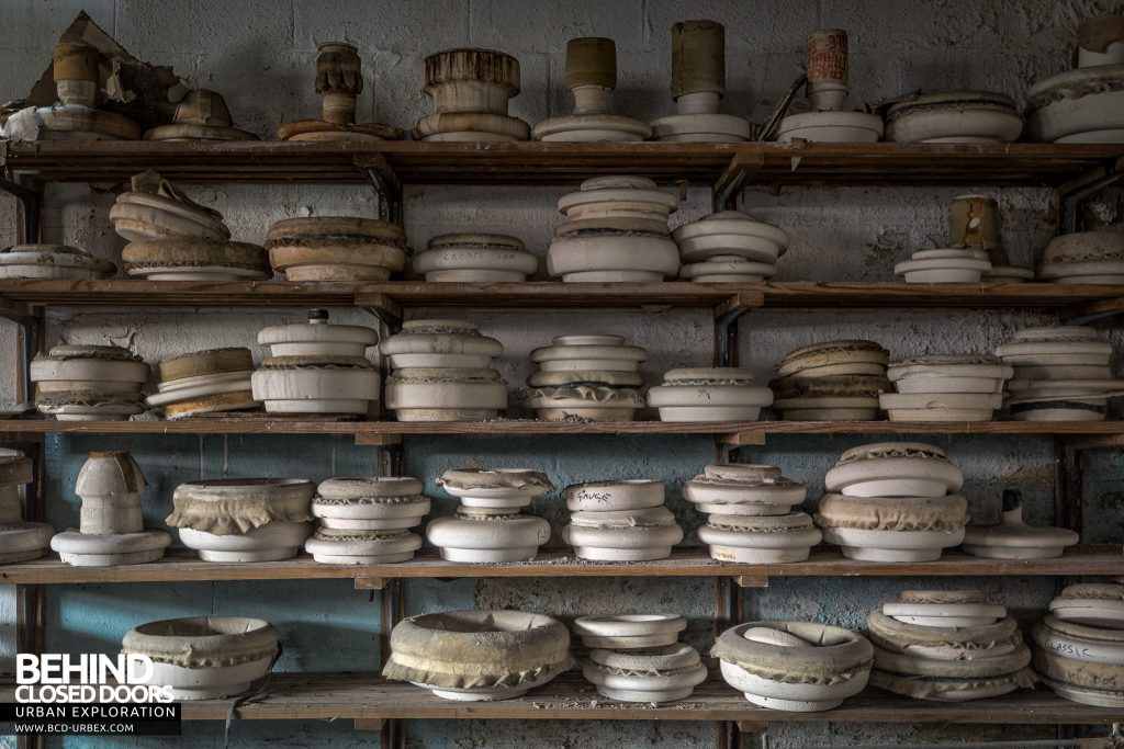 T. G. Greens Pottery - Shelves stacked with unpainted pots