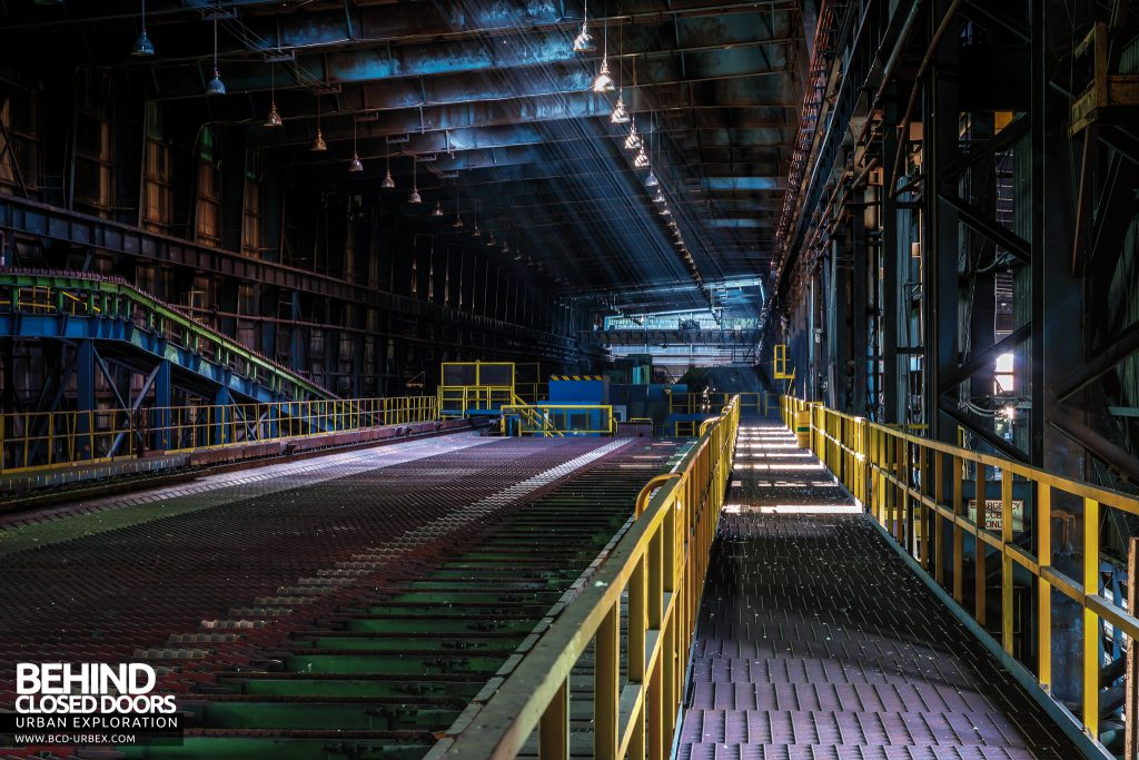 Thamesteel Sheerness - Light beams above the conveyors used for cooling finished bar